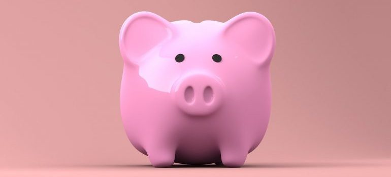 Pink piggy bank in which to save money for your upcoming relocation.