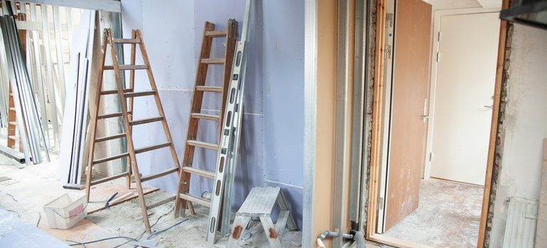 Tools you will need to remodel your Idaho home in a month arranged in an empty hallway.