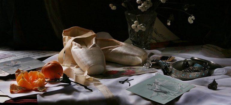 Ballet shoes on a desk.