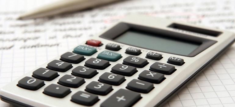 A calculator, pen, and paper