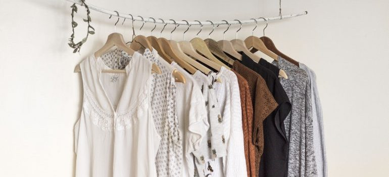 Shirts on hangers to include when getting ready to pack clothes for moving.
