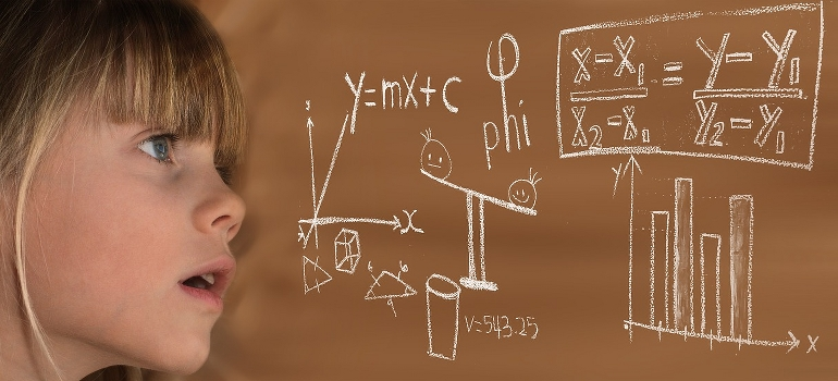 A girl looking at some complicated calculations