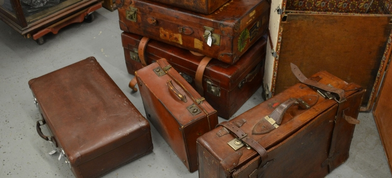 several old leather suitcases
