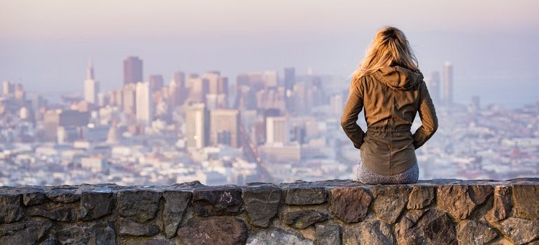 Person watching a city skyline.