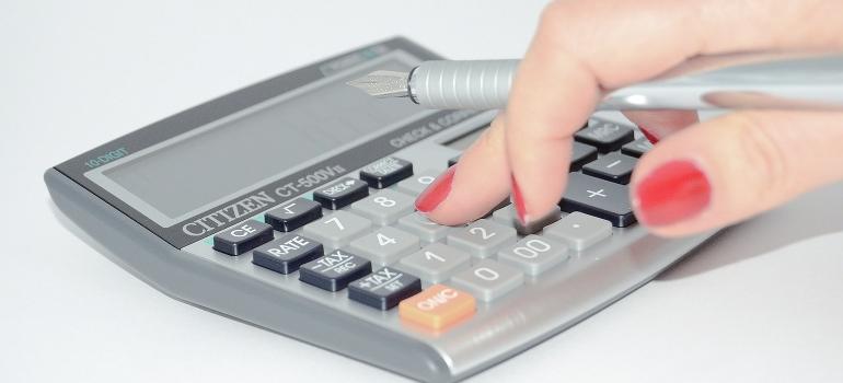 finger pressing calculator buttons