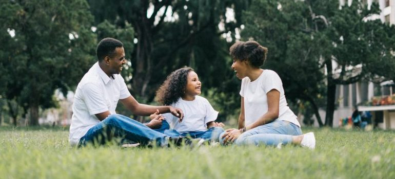 family-sitting-in-the-park