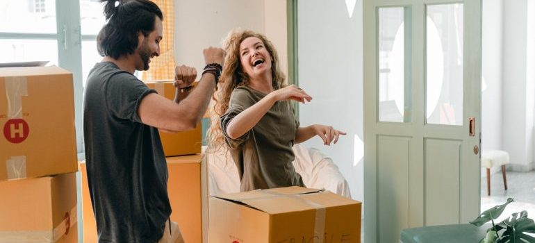 Happy couple packing items after they find good long-term storage solutions