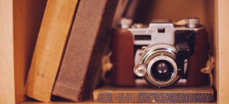Three books and a camera.