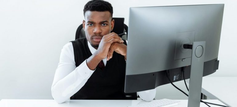 man sitting at the office desk