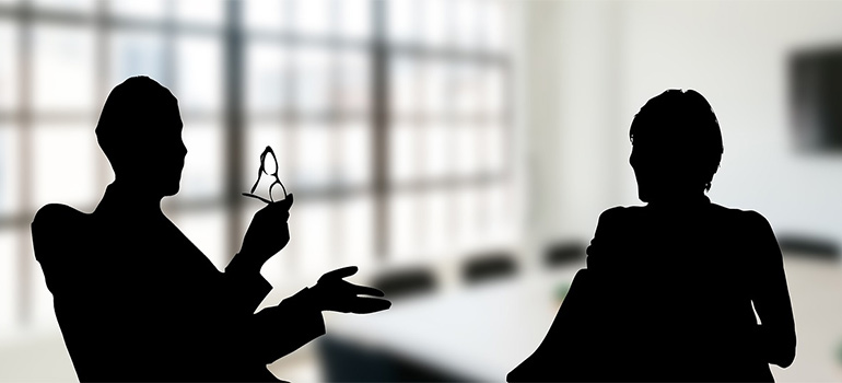 two silhouettes talking