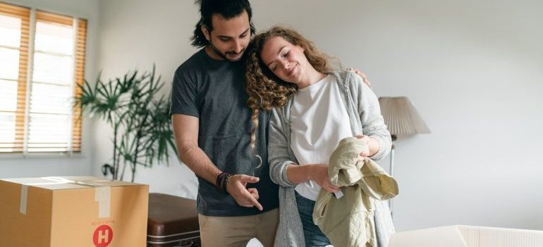 Couple packing together to make moving in together simpler