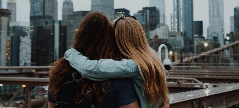 two female friends, hugging