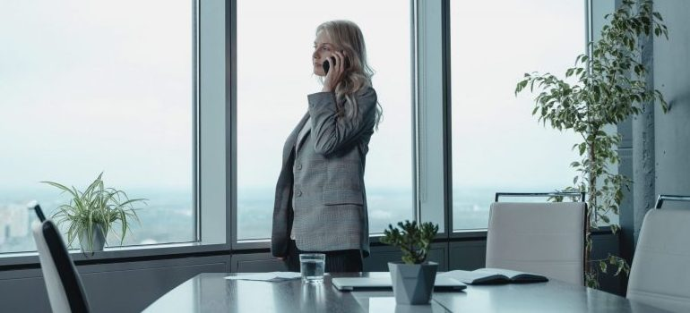 woman in the office, talking on the phone