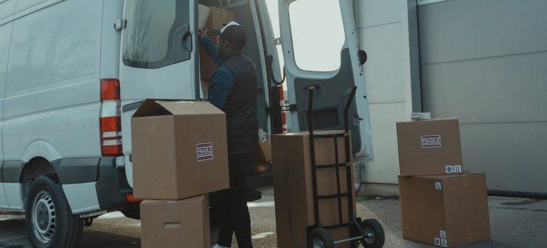 person unloading a mini van