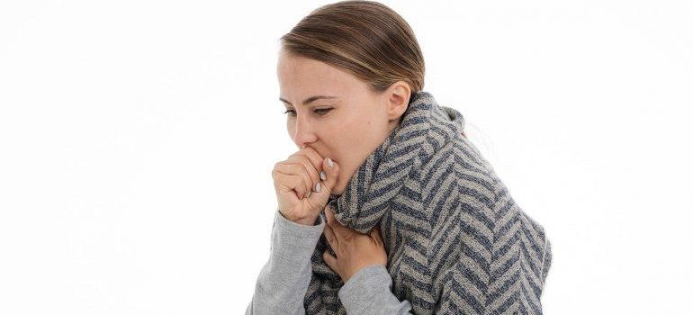 A woman that is coughing.