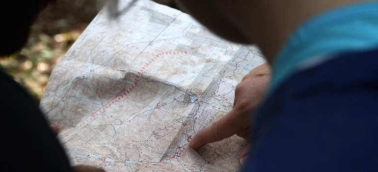 a person looking at a map