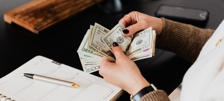 Woman planning a budget after learning when movers can charge you extra