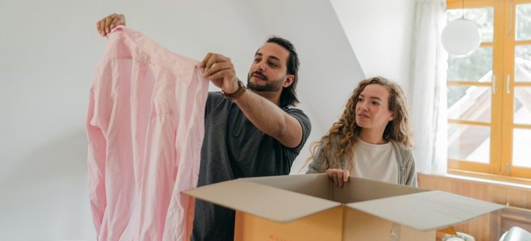 Couple decluttering home during COVID-19
