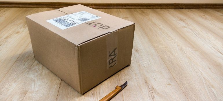 A moving box on the floor.