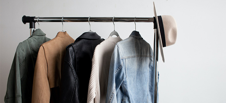 A hanger with a couple of jackets on it