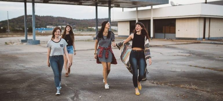 A group of women walking and laughing.