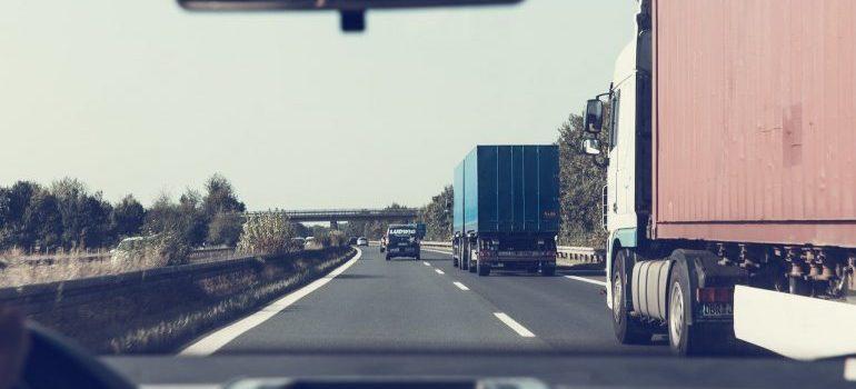 LTL shipping trucks on the road.