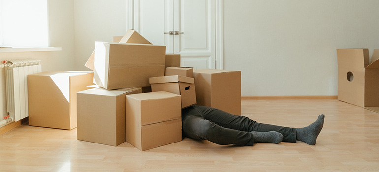 A man under boxes