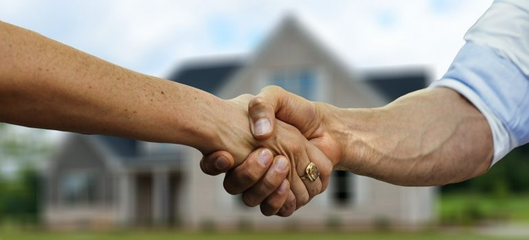 A handshake between two people after helping out your movers.