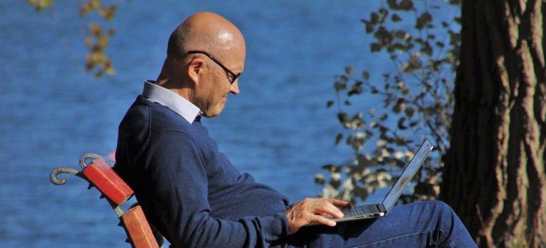 Elderly man using laptop.