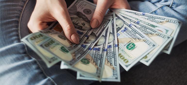 A woman holding cash