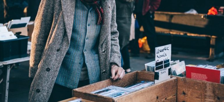 A man looking through records at a garage sale.