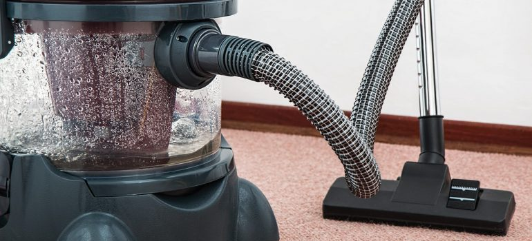 A vacuum cleaner on a rug.