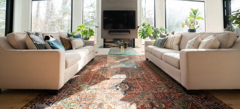 A colorful area rug in a living room.