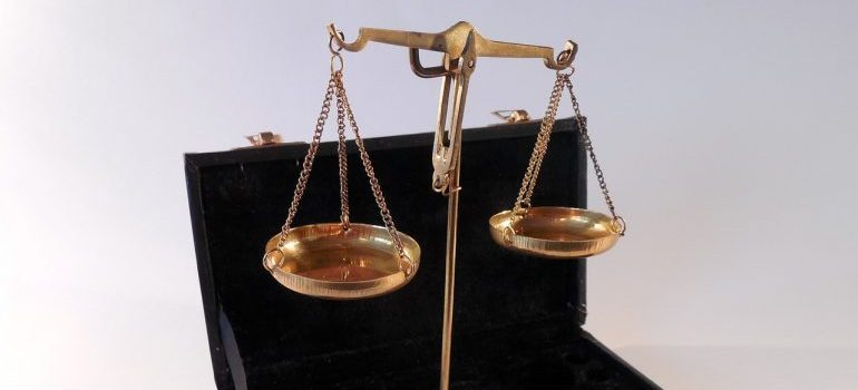 Brass scales in a black box.