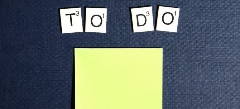 """Scrabble tiles spelling """"to do"""" above post-it notes."""