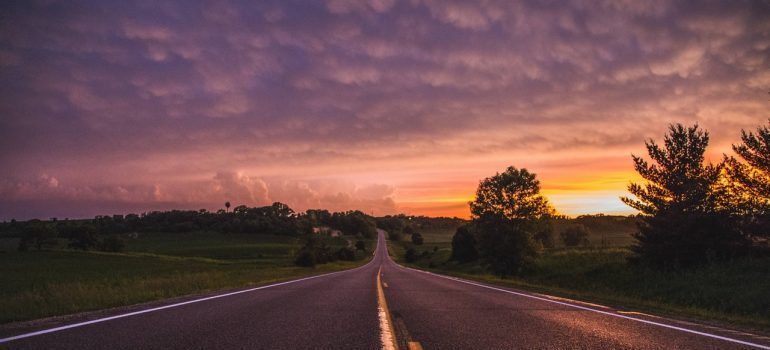 A long road at sunset.