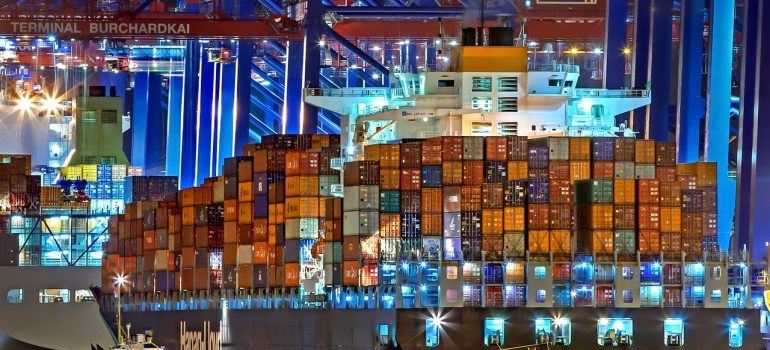A freight ship stacked with crates