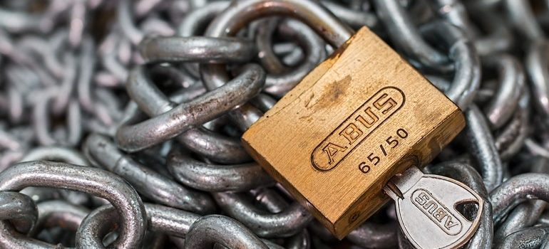 Padlock on a chain with a key inserted.
