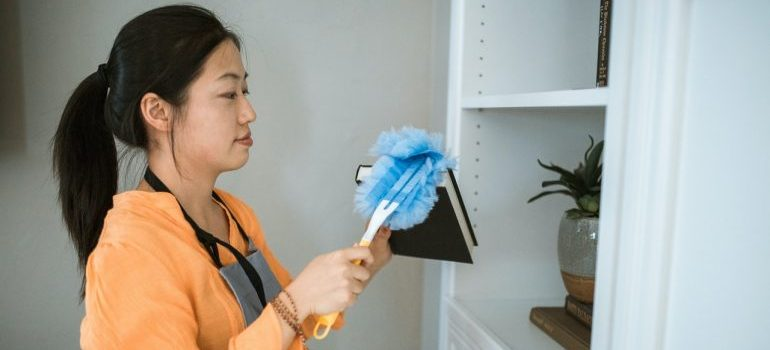 Woman cleaning before moving into a new house