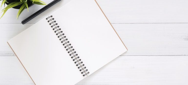 Notebook and pen you need to write down Moving tips for people with disabilities.
