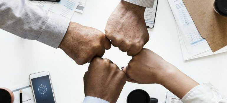 A group of people bumping hands.