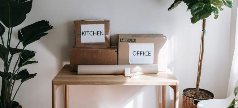 """two boxes labeled """"kitchen"""" and """"office"""""""