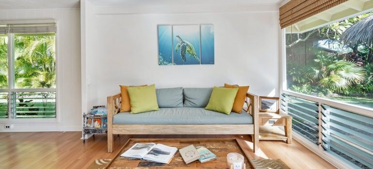 A living room with a painting of turtle on the wall.