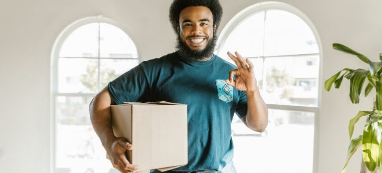 Man carrying an essentials box