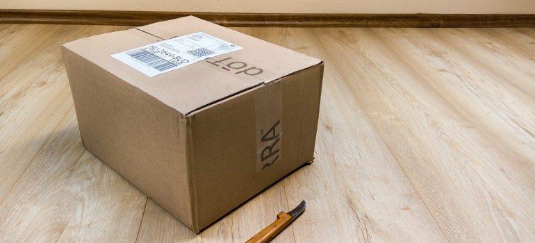 A cardboard box on the floor.