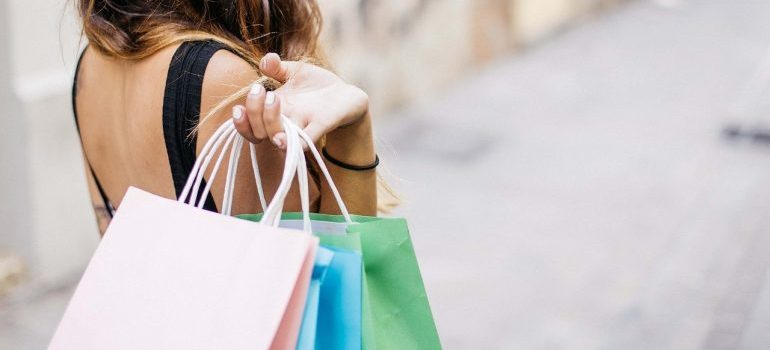 A woman going shopping - a bad way to avoid clutter after moving.