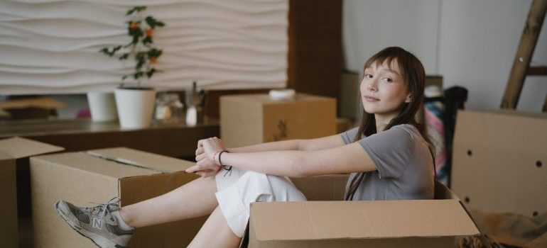 Woman getting ready to pack after learning the tips for moving a pool table