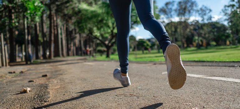 feet running on a road
