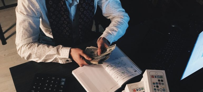 A man counting money.