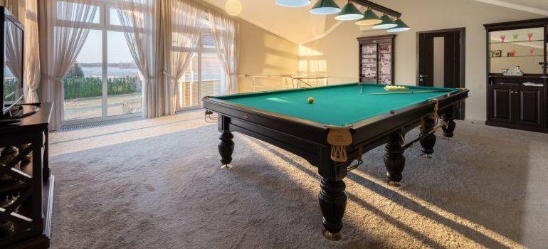 A pool table inside a room